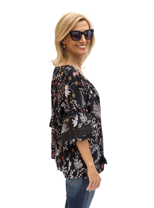 side viewblack print blouse with ruffle sleeves and lace trim