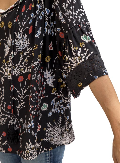black print blouse with ruffle sleeves and lace trim close up