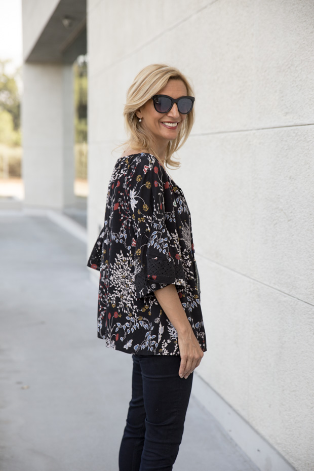 casual black floral print top with lace trim side view