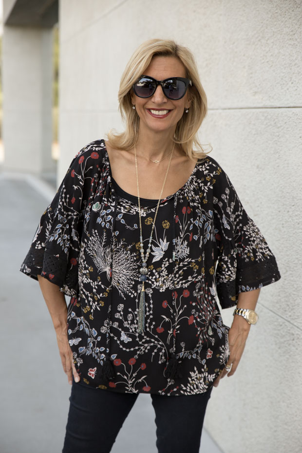 black floral print top with lace trim close up