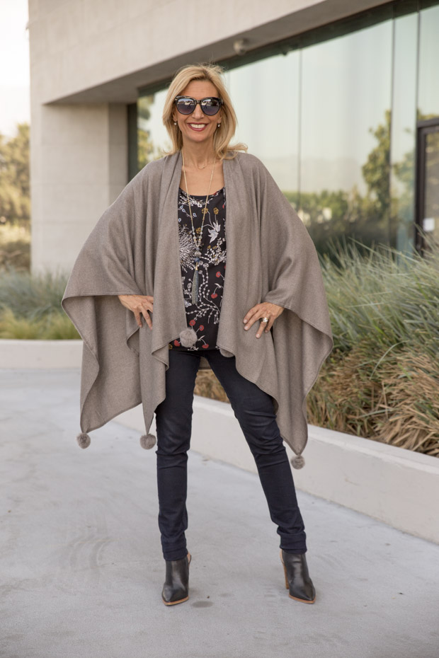 womens stone colored poncho with fur ball trim