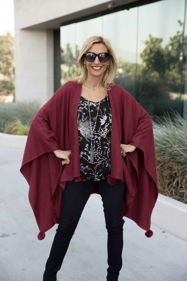 womens burgandy color poncho with fur ball trim
