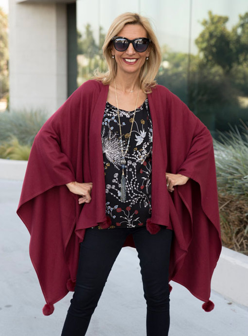 burgandy poncho with fur ball tassels