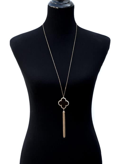 gold tone necklace with black rhinestone clover and fringe