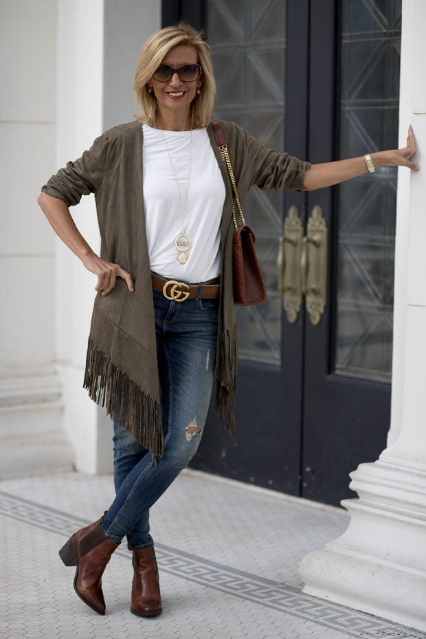 olive faux suede jacket with fringe and Ivory ruffle sleeve jersey blouse