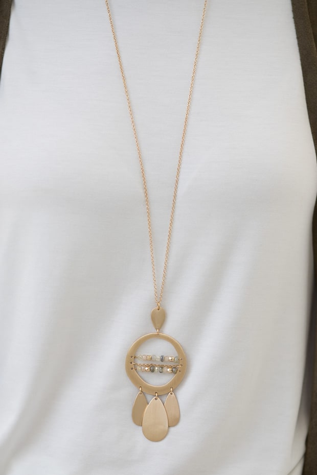 Ivory ruffle sleeve jersey top for women with matt gold pendant necklace