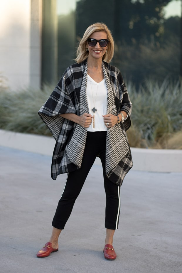 How to add a touch of red when mixing patterns for a fall outfit gray black ivory plaid poncho