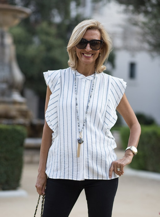 white sleeveless shirt with ruffle sleeve detail