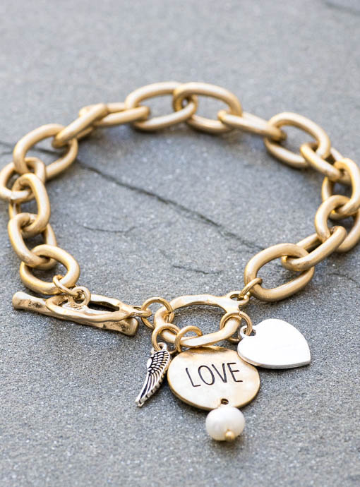Love Charms on a gold tone bracelet