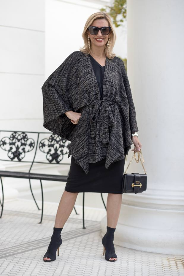 A Holiday Party Look in a Black and gold lurex knit poncho cardigan
