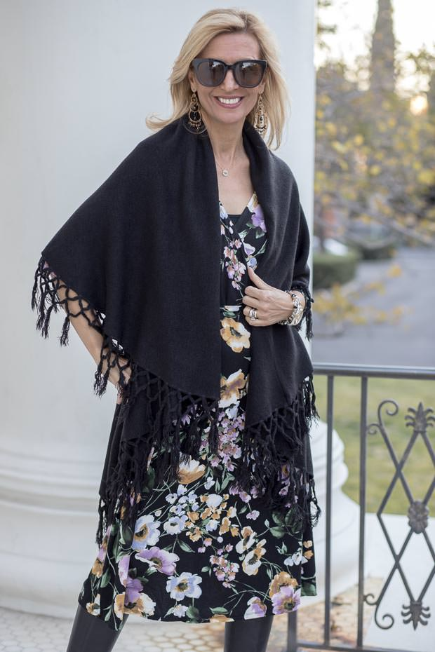 Black Floral Print Jersey Faux wrap dress worn with cape vest