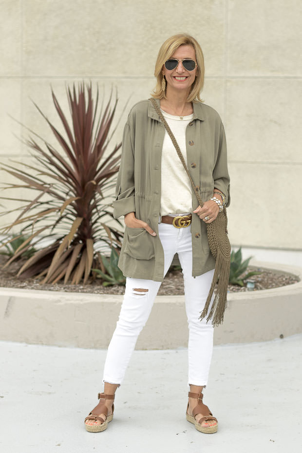 olive two pocket jacket with white jeans