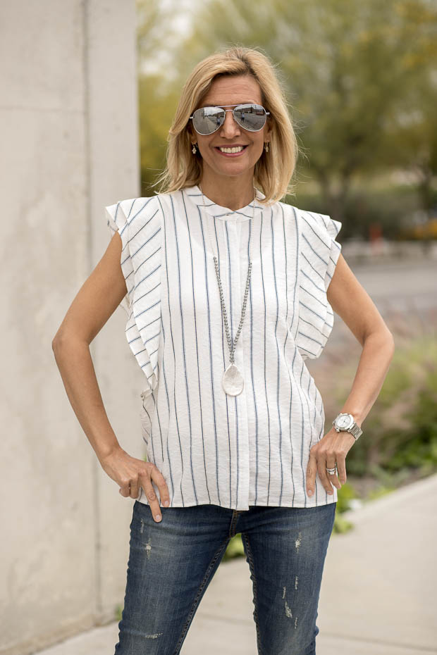 stripe sleeveless shirt with ruffle detail
