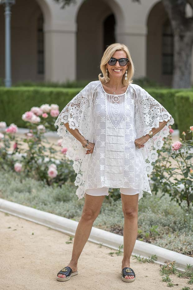 Womens White lace poncho with white shorts