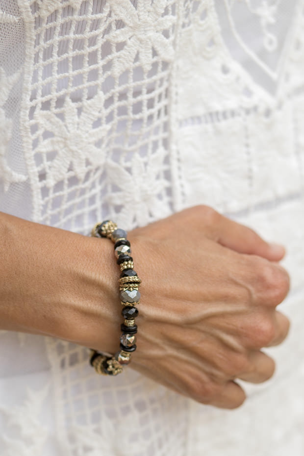 Gunmetal gray and black beads with gold tone accent bracelet for women