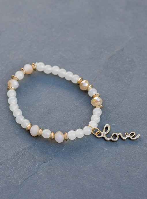 Set Of Six Ivory And Gold Bracelets With Charms